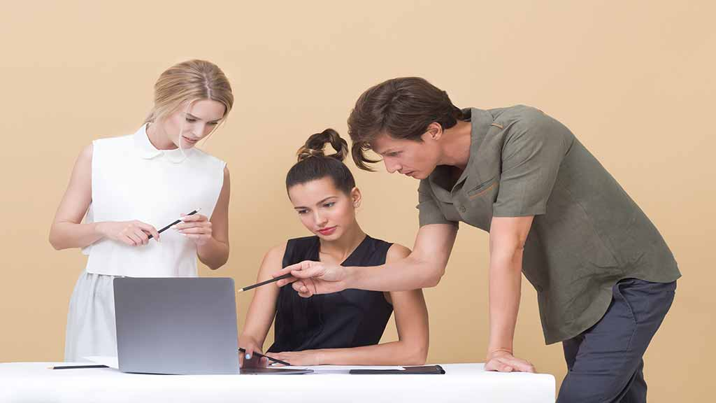 two-woman-and-one-man-looking-at-the-laptop-1036641